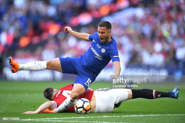 Eden Hazard of Chelsea is fouled by Phil Jones of Manchester United for a penalty during The Emirates FA Cup Final between Chelsea and Manchester...