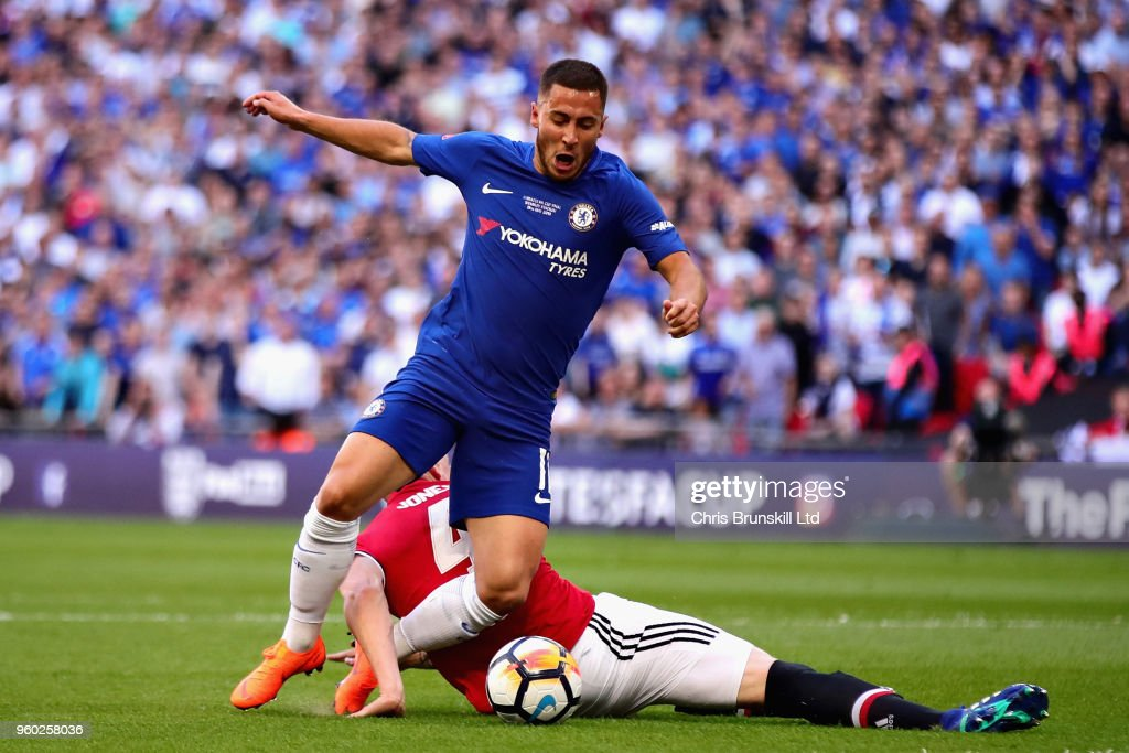 Eden Hazard of Chelsea is fouled by Phil Jones of Manchester United in the penalty area during the Emirates FA Cup Final between Chelsea and Manchester United at Wembley Stadium on May 19, 2018 in London, England.