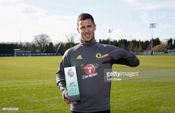 Eden Hazard of Chelsea is presented with the Carling Premier League Goal of the month award for February at Chelsea Training Ground on March 9 2017...