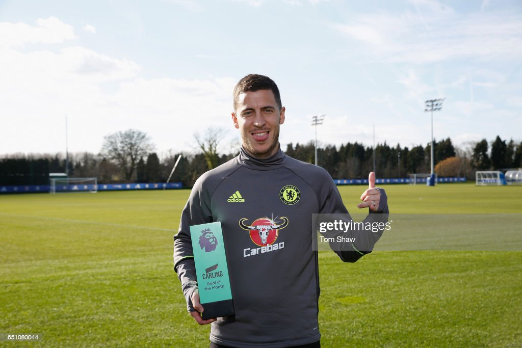 Eden Hazard of Chelsea is presented with the Carling Premier League Goal of the month award for February at Chelsea Training Ground on March 9, 2017 in Cobham, England.