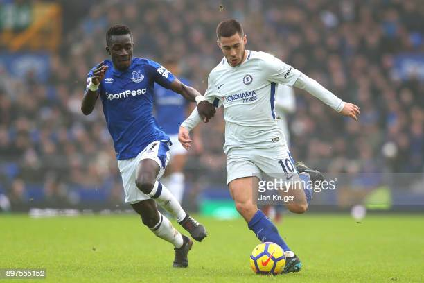Eden Hazard of Chelsea is put under pressure by Idrissa Gueye of Everton during the Premier League match between Everton and Chelsea at Goodison Park...
