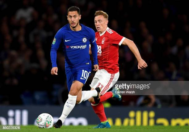 Eden Hazard of Chelsea is put under pressure from Ben Osborn of Nottingham Forest during the Carabao Cup Third Round match between Chelsea and...