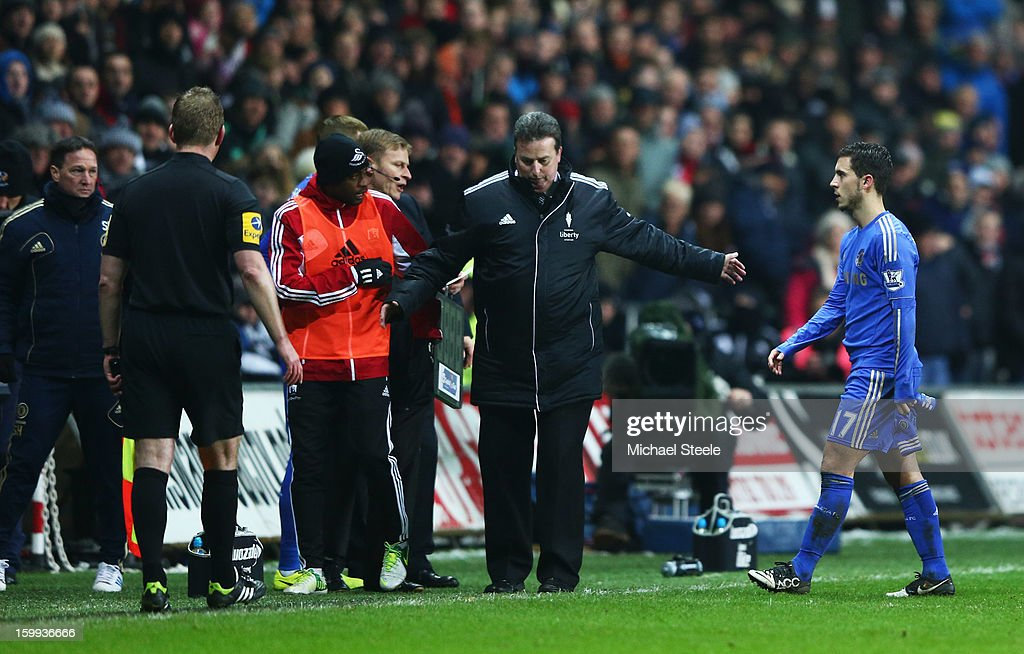 Eden Hazard of Chelsea (R) is sent off after kicking a ball boy during the Capital One Cup Semi-Final Second Leg match between Swansea City and Chelsea at Liberty Stadium on January 23, 2013 in Swansea, Wales.