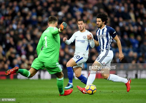 Eden Hazard of Chelsea is shadowed by Ahmed ElSayed Hegazi as Ben Foster of West Bromwich Albion clears the ball during the Premier League match...