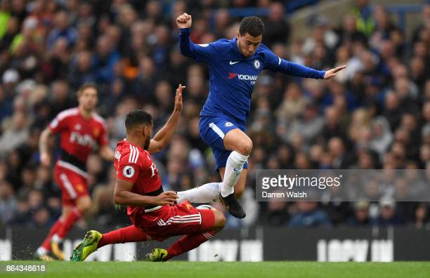 Eden Hazard of Chelsea is tackled by Adrian Mariappa of Watford during the Premier League match between Chelsea and Watford at Stamford Bridge on...