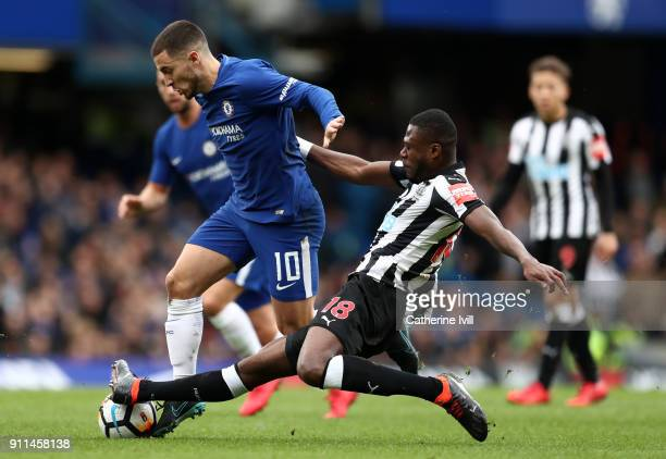 Eden Hazard of Chelsea is tackled by Chancel Mbemba of Newcastle United during the Emirates FA Cup Fourth Round match between Chelsea and Newcastle...