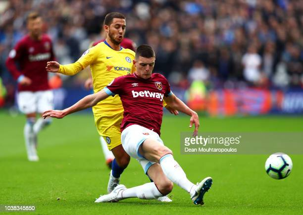 Eden Hazard of Chelsea is tackled by Declan Rice of West Ham United during the Premier League match between West Ham United and Chelsea FC at London...