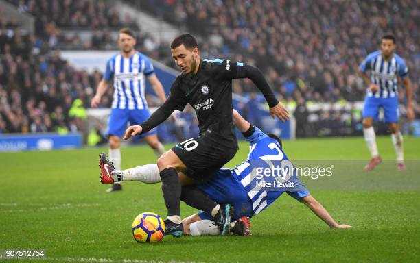 Eden Hazard of Chelsea is tackled by Markus Suttner of Brighton and Hove Albion during the Premier League match between Brighton and Hove Albion and...