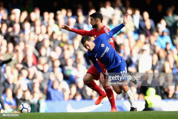 Eden Hazard of Chelsea is tackled by Miguel Britos of Watford during the Premier League match between Chelsea and Watford at Stamford Bridge on...