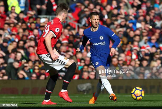 Eden Hazard of Chelsea is tackled by Scott McTominay of Manchester United during the Premier League match between Manchester United and Chelsea at...