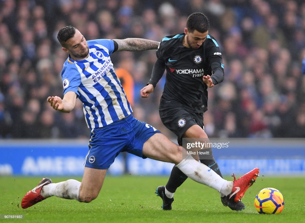 Eden Hazard of Chelsea is tackled by Shane Duffy of Brighton during the Premier League match between Brighton and Hove Albion and Chelsea at Amex Stadium on January 20, 2018 in Brighton, England.