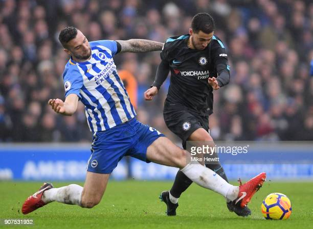 Eden Hazard of Chelsea is tackled by Shane Duffy of Brighton during the Premier League match between Brighton and Hove Albion and Chelsea at Amex...