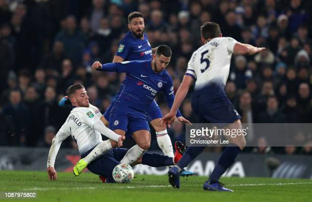 Eden Hazard of Chelsea is tackled by Toby Alderweireld of Tottenham Hotspur during the Carabao Cup SemiFinal Second Leg match between Chelsea and...