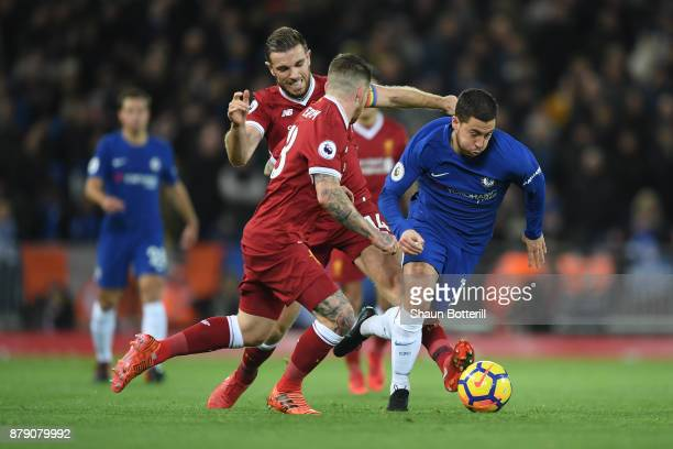 Eden Hazard of Chelsea Jordan Henderson of Liverpool and Alberto Moreno of Liverpool battle for possession during the Premier League match between...