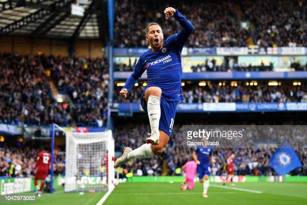 Eden Hazard of Chelsea jumps in the air as he celebrates scoring the opening goal during the Premier League match between Chelsea FC and Liverpool FC...