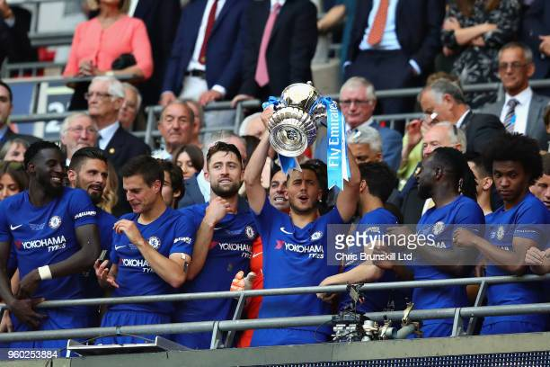 Eden Hazard of Chelsea lifts the FA Cup trophy after his side won during the Emirates FA Cup Final between Chelsea and Manchester United at Wembley...