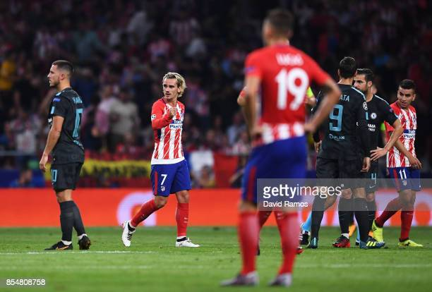 Eden Hazard of Chelsea looks dejected as Antoine Griezmann of Atletico Madrid celebrates after he scores his sides first goal from the penalty spot...