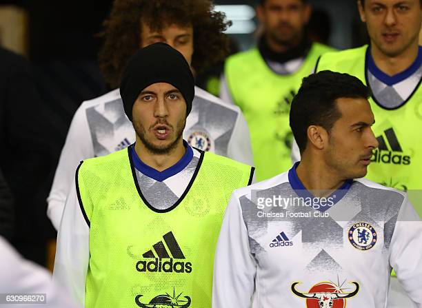Eden Hazard of Chelsea looks on as he waits to enter the field of play to warm up prior to the Premier League match between Tottenham Hotspur and...