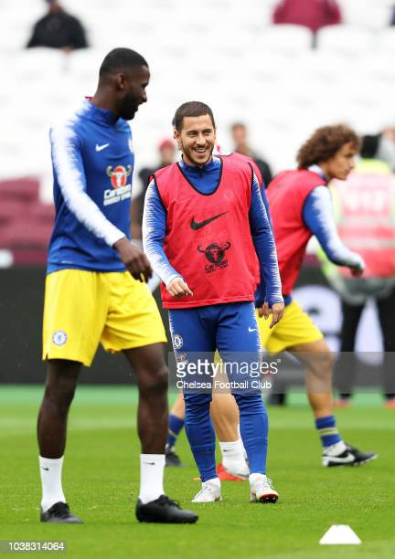 Eden Hazard of Chelsea looks on as he warms up prior to the Premier League match between West Ham United and Chelsea FC at London Stadium on...