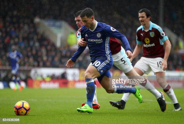 Eden Hazard of Chelsea moves away from Michael Keane of Burnley during the Premier League match between Burnley and Chelsea at Turf Moor on February...
