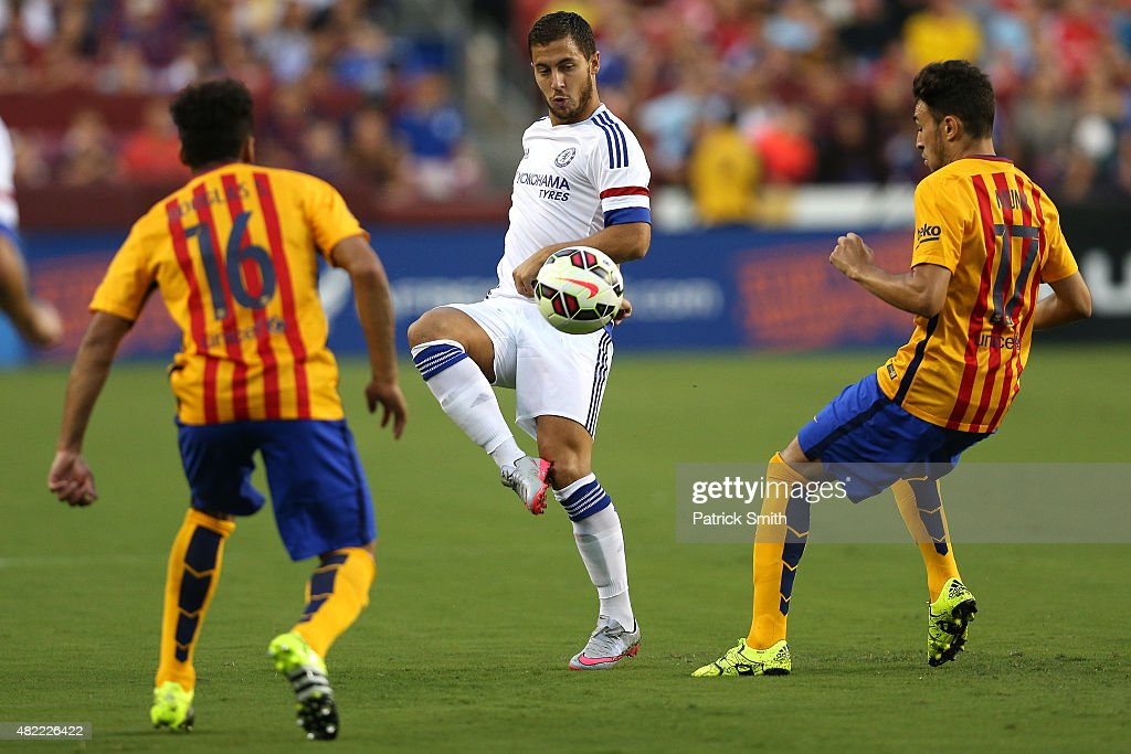 Eden Hazard #10 of Chelsea passes between two Barcelona defenders in the first half during the International Champions Cup North America at FedExField on July 28, 2015 in Landover, Maryland.
