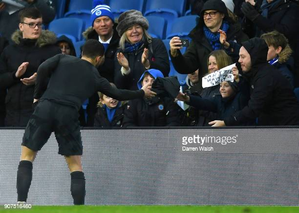 Eden Hazard of Chelsea passes his shirt to a young fan following the Premier League match between Brighton and Hove Albion and Chelsea at Amex...