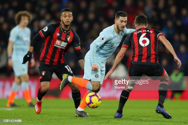 Eden Hazard of Chelsea passes the ball under pressure from Andrew Surman of AFC Bournemouth during the Premier League match between AFC Bournemouth...