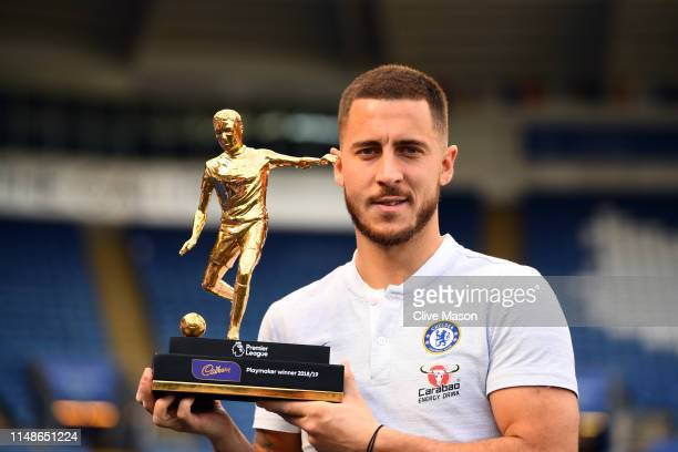 Eden Hazard of Chelsea poses for a photo with the Playmaker winner trophy after the Premier League match between Leicester City and Chelsea FC at The...