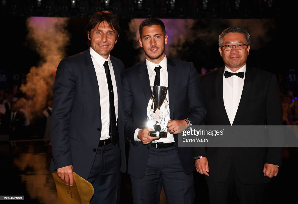 Eden Hazard of Chelsea poses with the Player of The Year award with Antonio Conte, Manager of Chelsea during the Chelsea Player of the Year awards at Battersea Evolution on May 28, 2017 in London, England.