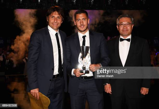 Eden Hazard of Chelsea poses with the Player of The Year award with Antonio Conte Manager of Chelsea during the Chelsea Player of the Year awards at...