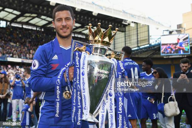 Eden Hazard of Chelsea poses with the Premier League trophy after the Premier League match between Chelsea and Sunderland at Stamford Bridge on May...
