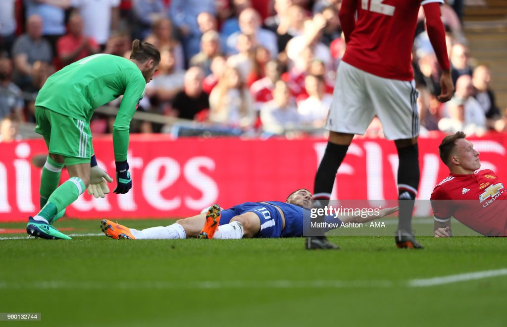 Eden Hazard of Chelsea reacts to being fouled by Phil Jones of Manchester United for a penalty during the Emirates FA Cup Final between Chelsea and Manchester United at Wembley Stadium on May 19, 2018 in London, England.