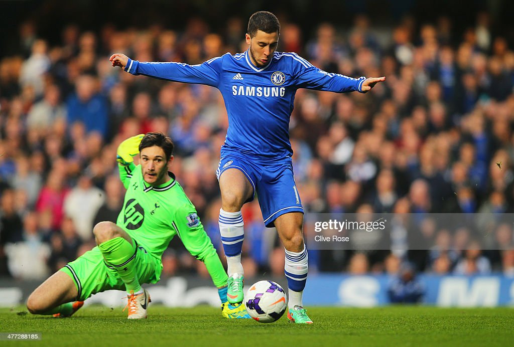 Eden Hazard of Chelsea rounds goalkeeper Hugo Lloris of Spurs, but puts his shot wide of theopen goal during the Barclays Premier League match between Chelsea and Tottenham Hotspur at Stamford Bridge on March 8, 2014 in London, England.