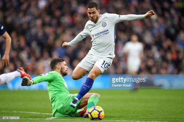 Eden Hazard of Chelsea runs past Ben Foster of West Bromwich Albion to score his side's second goal during the Premier League match between West...