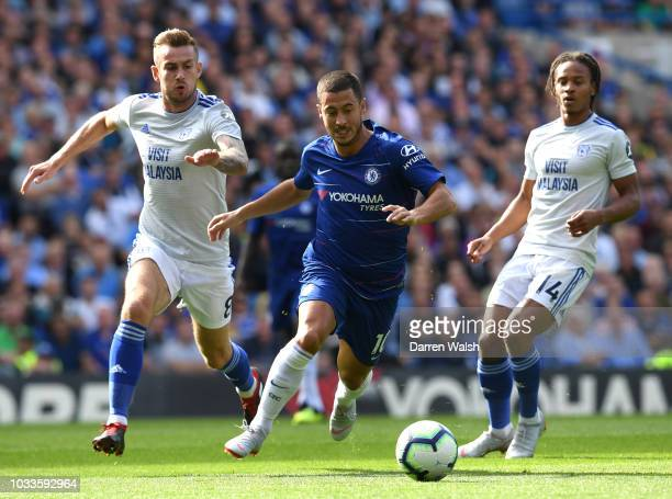 Eden Hazard of Chelsea runs past Joe Ralls of Cardiff City during the Premier League match between Chelsea FC and Cardiff City at Stamford Bridge on...