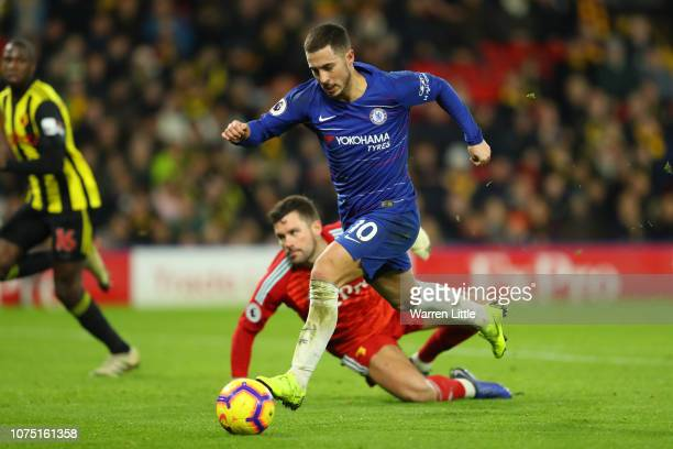 Eden Hazard of Chelsea runs to score his team's first goal past Ben Foster of Watford during the Premier League match between Watford FC and Chelsea...