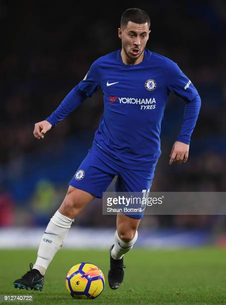 Eden Hazard of Chelsea runs with the ball during the Premier League match between Chelsea and AFC Bournemouth at Stamford Bridge on January 31 2018...