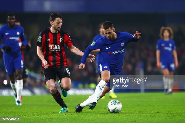 Eden Hazard of Chelsea runs with the ball under pressure from Harry Arter of AFC Bournemouth during the Carabao Cup QuarterFinal match between...