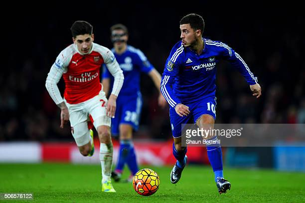 Eden Hazard of Chelsea runs with the ball under pressure from Hector Bellerin of Arsenal during the Barclays Premier League match between Arsenal and...