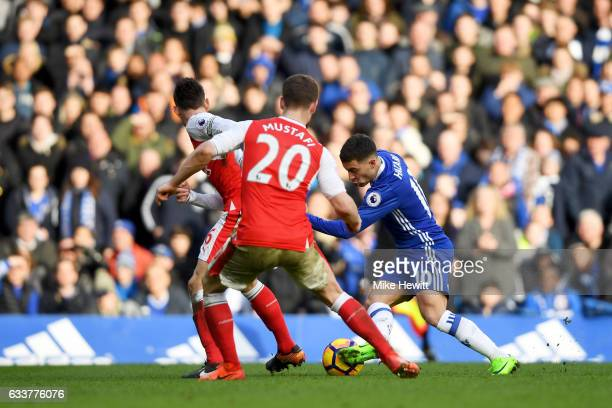 Eden Hazard of Chelsea rus through to score his team's second goal during the Premier League match between Chelsea and Arsenal at Stamford Bridge on...
