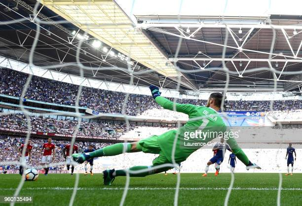 Eden Hazard of Chelsea scores a penalty for his sides first goal past David De Gea of Manchester United during The Emirates FA Cup Final between...