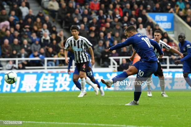 Eden Hazard of Chelsea scores a penalty for his team's first goal during the Premier League match between Newcastle United and Chelsea FC at St James...
