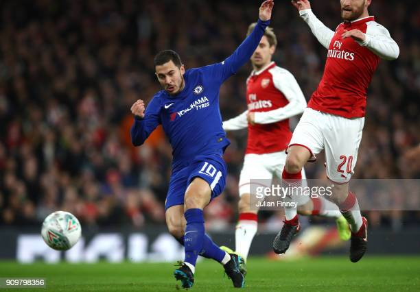 Eden Hazard of Chelsea scores his sides first goal during the Carabao Cup SemiFinal Second Leg at Emirates Stadium on January 24 2018 in London...