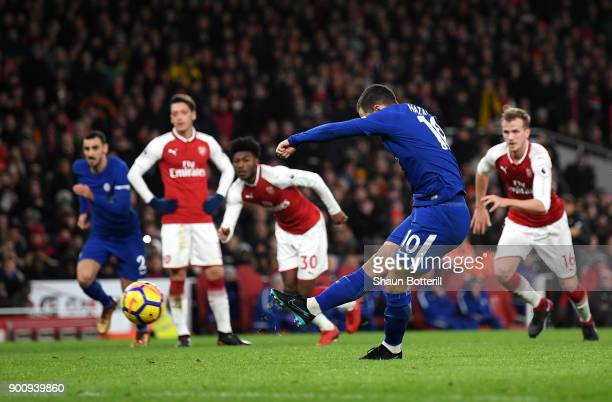 Eden Hazard of Chelsea scores his sides first goal from the penalty spot during the Premier League match between Arsenal and Chelsea at Emirates...