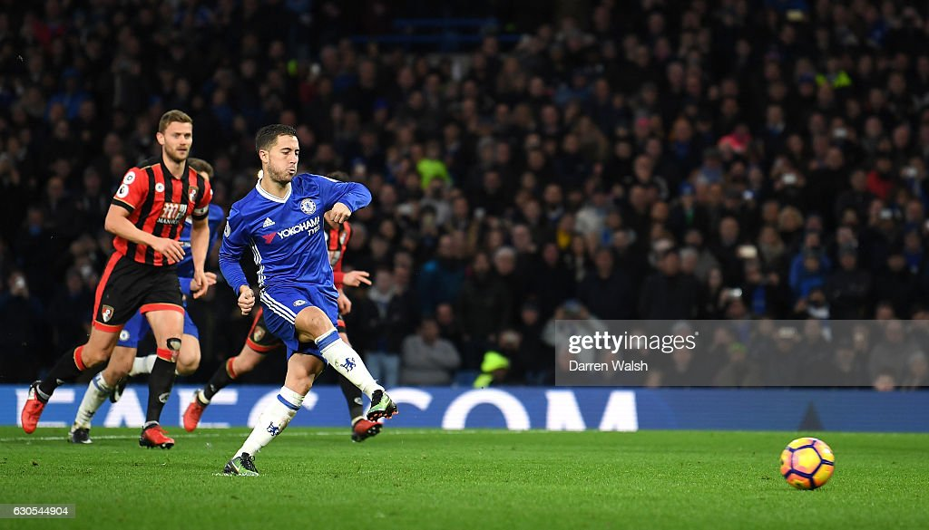 Eden Hazard of Chelsea scores his sides second goal from the penalty spot during the Premier League match between Chelsea and AFC Bournemouth at Stamford Bridge on December 26, 2016 in London, England.