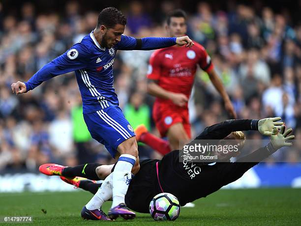 Eden Hazard of Chelsea scores his sides second goal past Kasper Schmeichel of Leicester City during the Premier League match between Chelsea and...