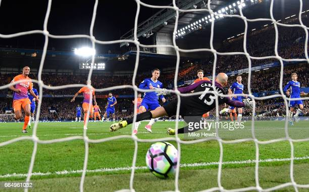 Eden Hazard of Chelsea scores his sides second goal past Willy Caballero of Manchester City during the Premier League match between Chelsea and...