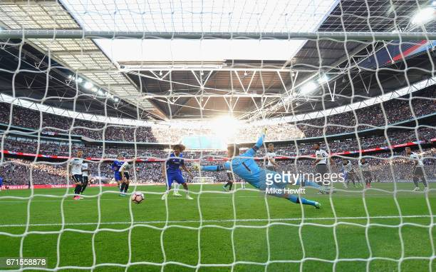 Eden Hazard of Chelsea scores his sides third goal as Hugo Lloris of Tottenham Hotspur attempts to save during The Emirates FA Cup SemiFinal between...