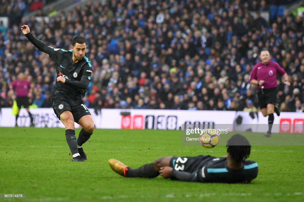 Eden Hazard of Chelsea scores his sides third goal during the Premier League match between Brighton and Hove Albion and Chelsea at Amex Stadium on January 20, 2018 in Brighton, England.
