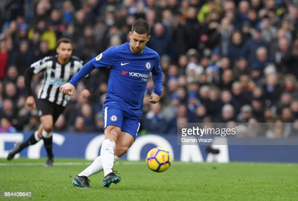 Eden Hazard of Chelsea scores his sides third goal from the penalty spot during the Premier League match between Chelsea and Newcastle United at...